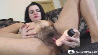 Hot hairy pregnant chick uses a big sex toy